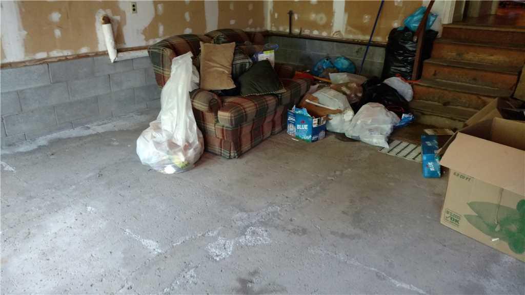 Fixing garage floor in Caz - Before Photo