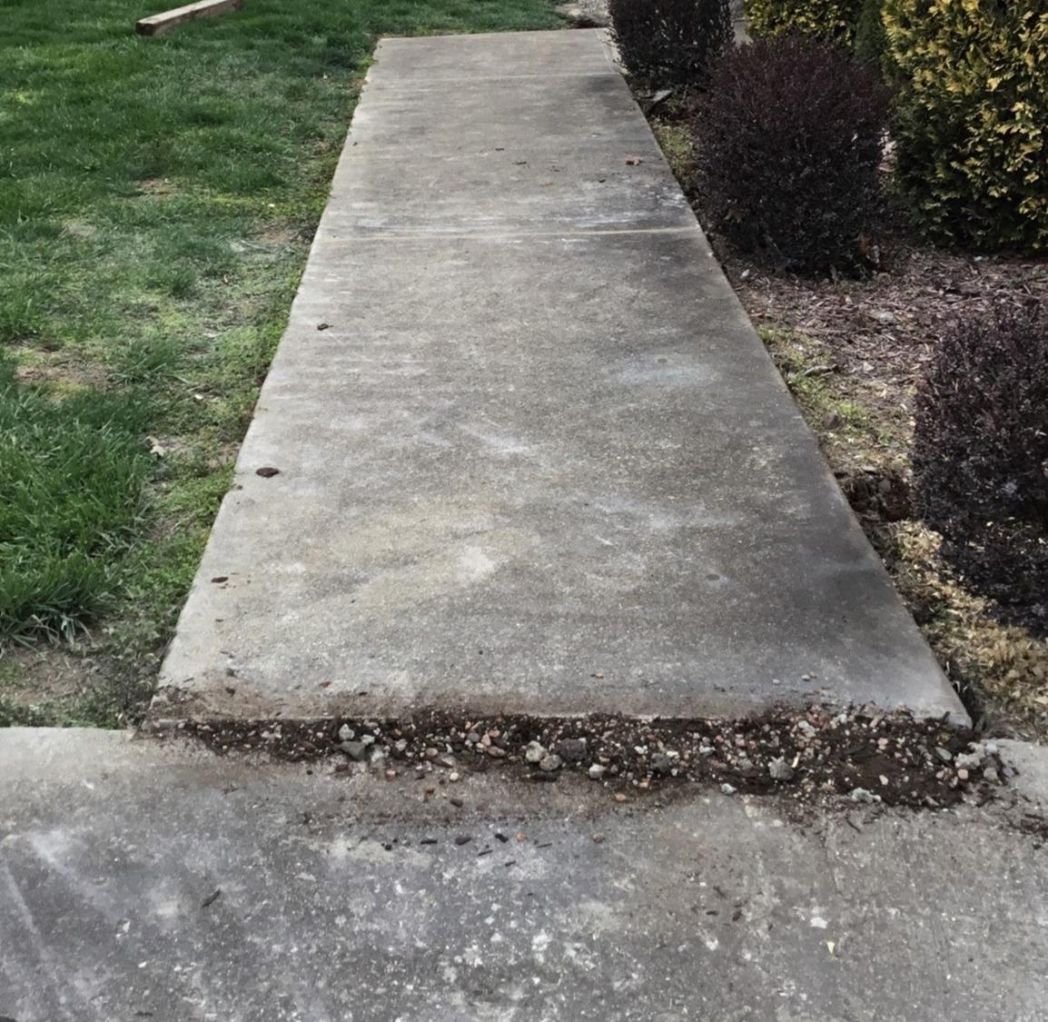 Polylevel Injection used to raise an unlevel sidewalk slab in Mt. Sterling, KY - Before Photo
