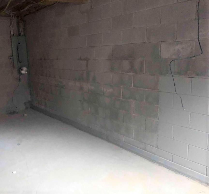 PowerBrace System  used to support a bowing wall in Lexington, KY. - Before Photo