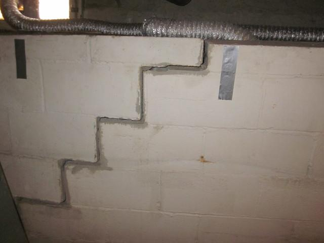 Lexington, KY Basement Wall Stabilized by PowerBraces and Cracks Repaired - Before Photo