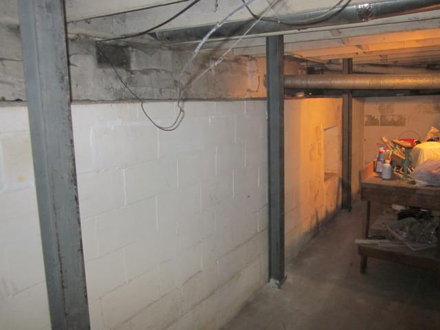 Lexington, KY Basement Wall Stabilized by PowerBraces and Cracks Repaired
