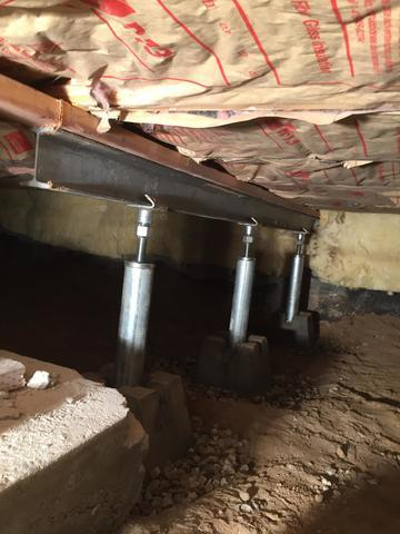 Failing floor joists re-supported with Crawlspace Smart Jacks in Nampa, ID.