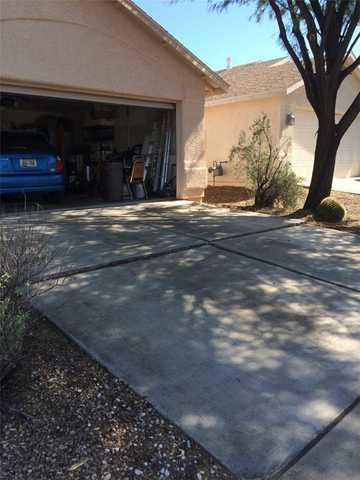 Tucson Driveway Settling Fixed with Mudjacking - Before Photo