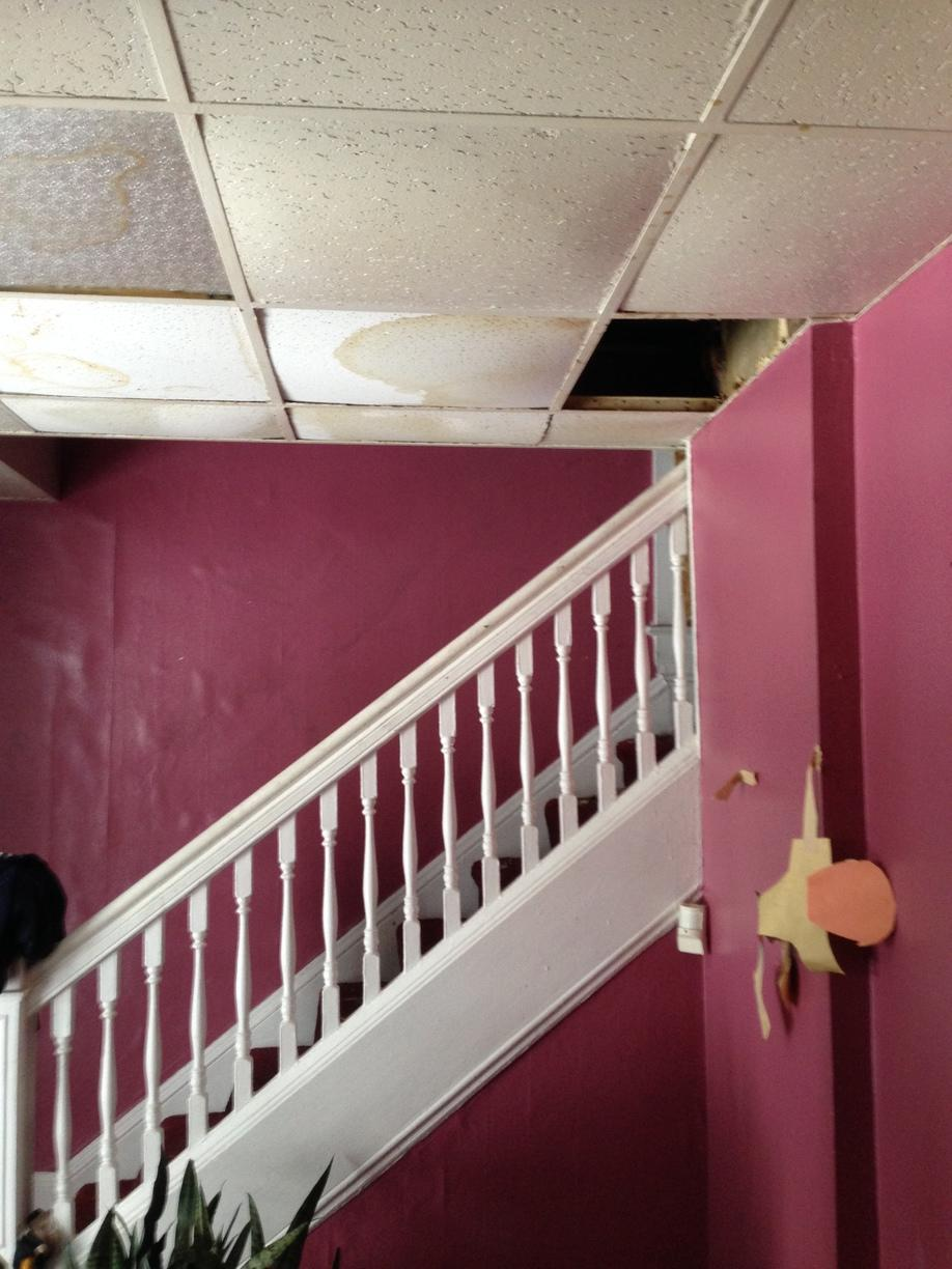 Water damage to hallway and staircase in Gates Mills, OH - Before Photo