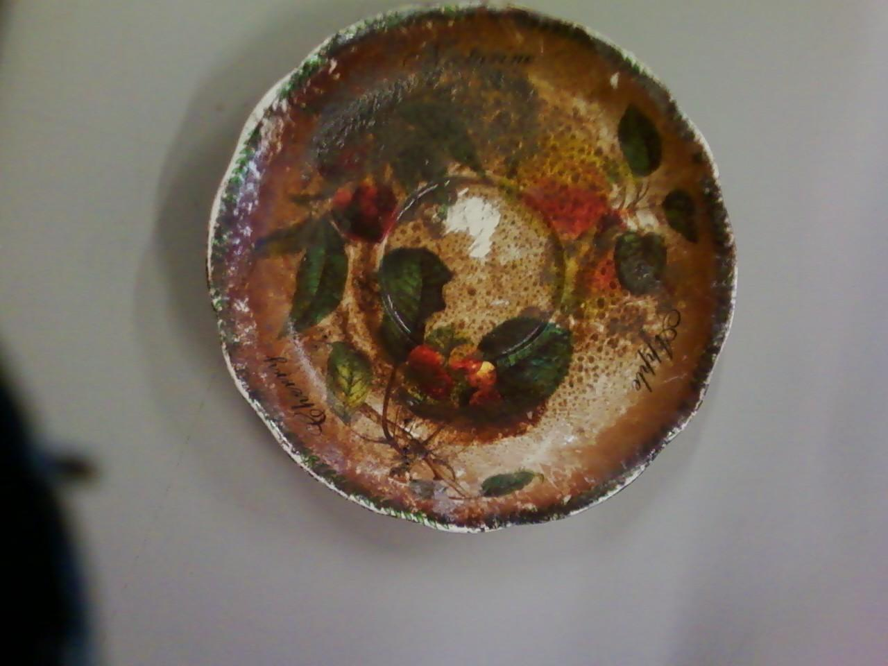 Painted bowl restored after sustaining fire damage - Before Photo
