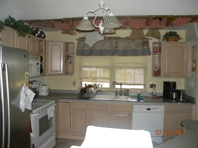Kitchen before and after in Painesville Twp. - Before Photo