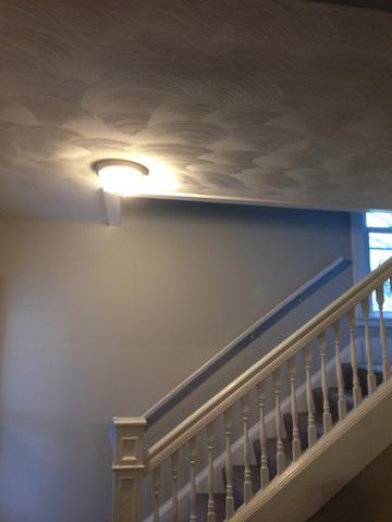 Water damage to hallway and staircase in Gates Mills, OH