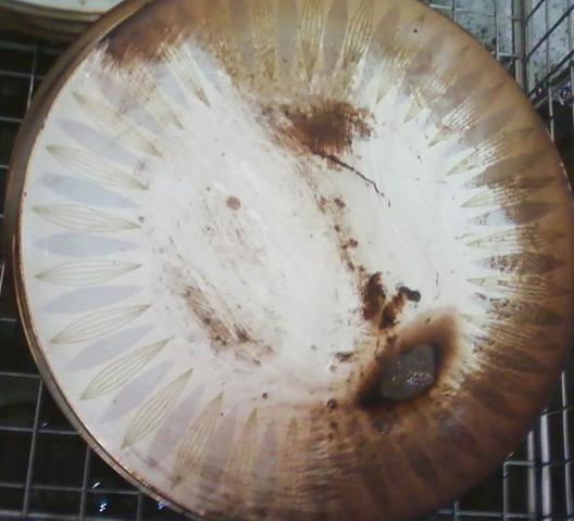 Plate damaged by fire and soot