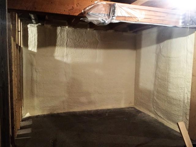 Oxford, NY Spray Foaming a Basement Wall