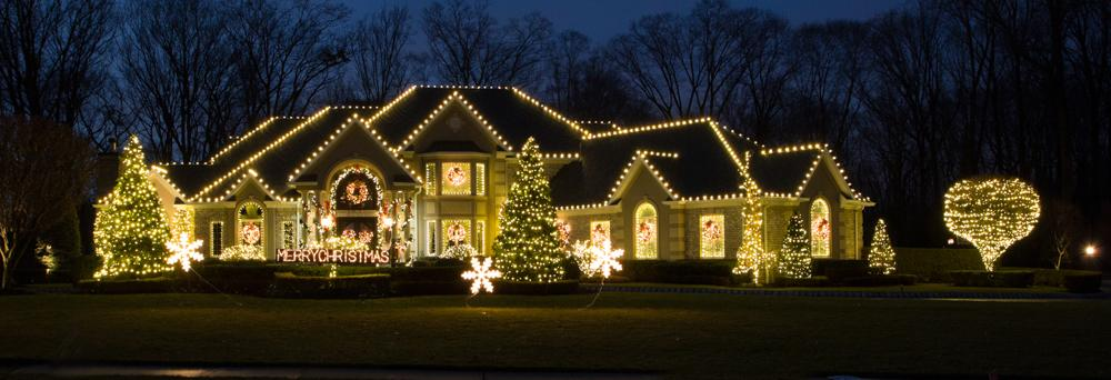 White lights adorn this house in Manalapan, NJ - After Photo