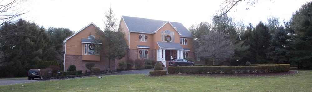 House on hill decorated for the holidays in Colts Neck, NJ - Before Photo