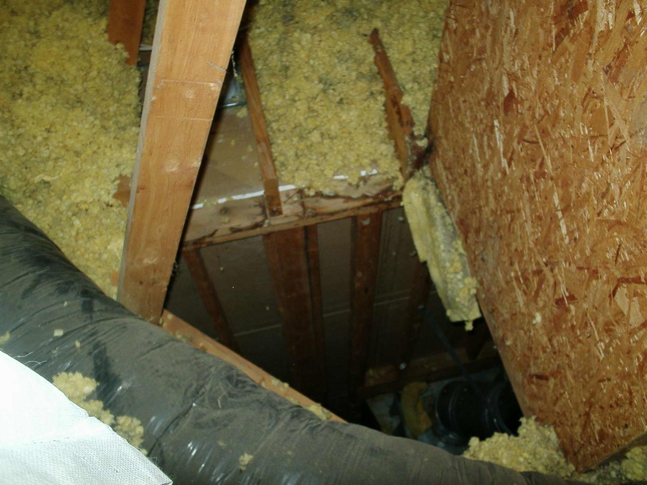 Sealing the Attic Leaks in Pittsboro, IN - Before Photo