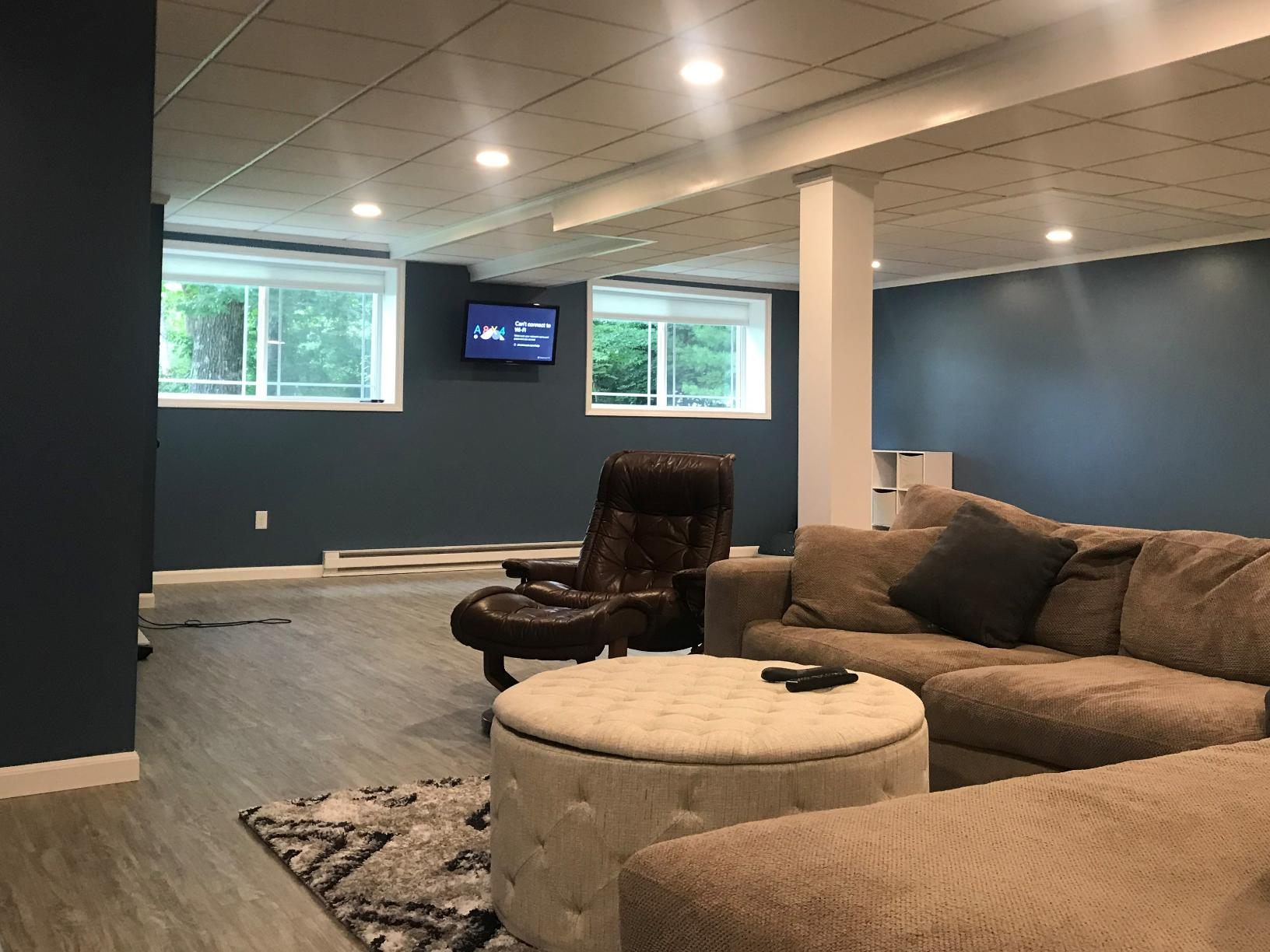 Roomy Man Cave Along with Spaces to Exercise and Read! - After Photo
