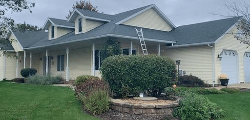 Hail Damaged Roof Replaced on Country Home near Mount Horeb - Before Photo