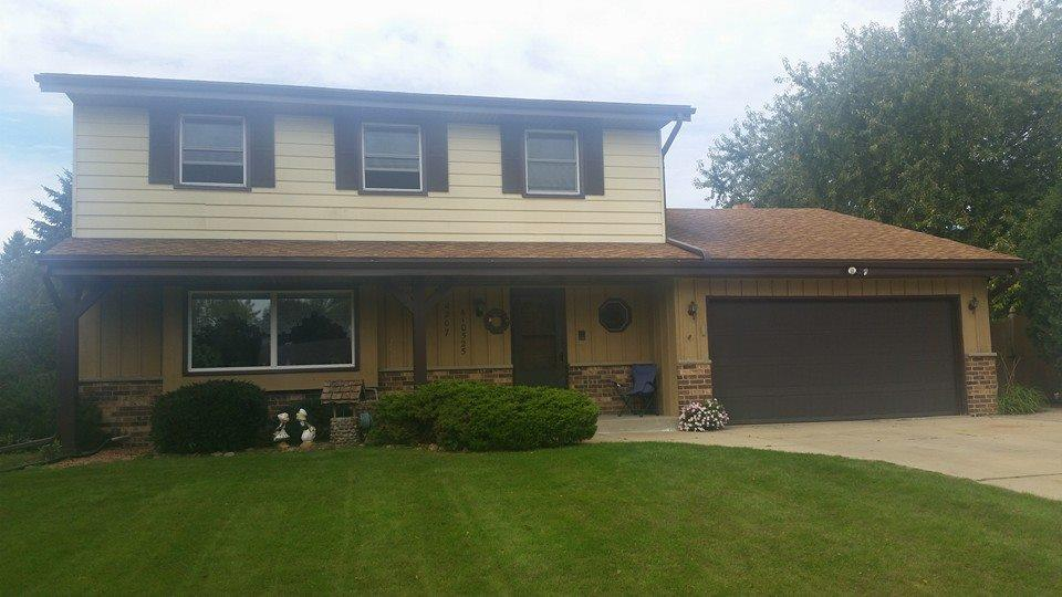 Roofing & Siding Transformation after Storm Damage - Before Photo