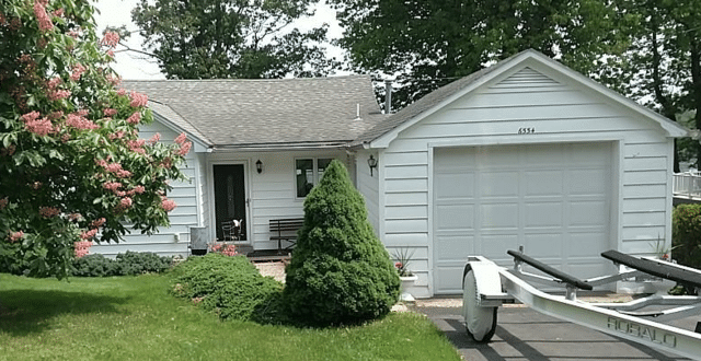 Updated Siding and Shutters on this Lake Home