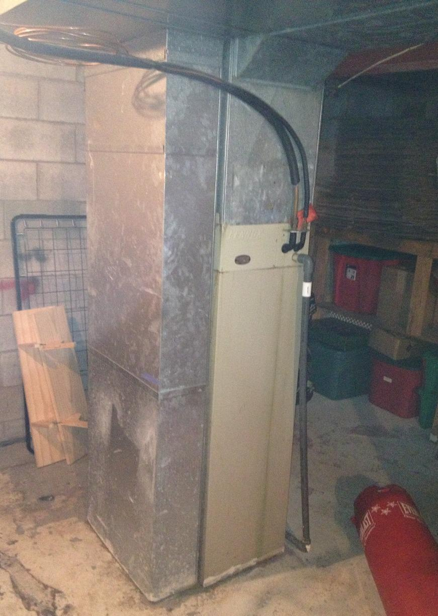 New High Efficiency Furnace and A/C Unit for Chili Commons - Before Photo