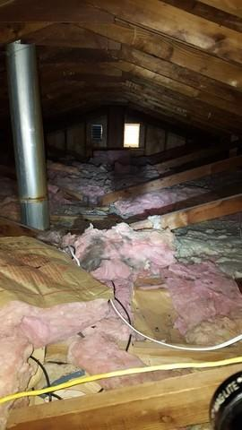 Attic insulation with wrapped flue pipe in Honeoye Falls, NY - Before Photo