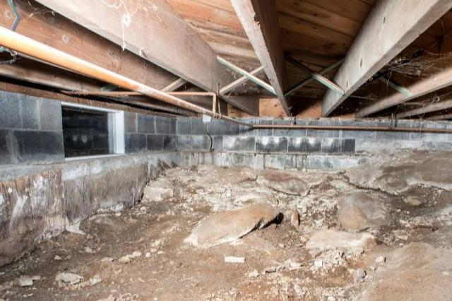 Crawl Space Insulation In Bourget ON - Before Photo