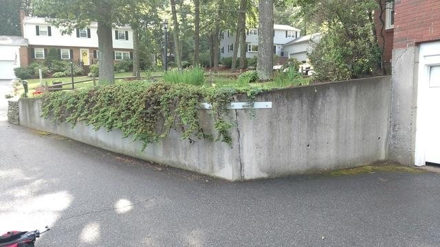 Leaning Retaining Wall Repair - Chelmsford, MA - Before Photo