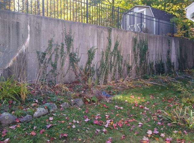Leaning Retaining Wall Repair - Before Photo