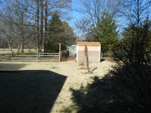 Cedar Wood Fence Installed in Granite City, IL - Before Photo