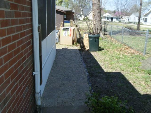Belleville, IL Picket Fence Installation - Before Photo