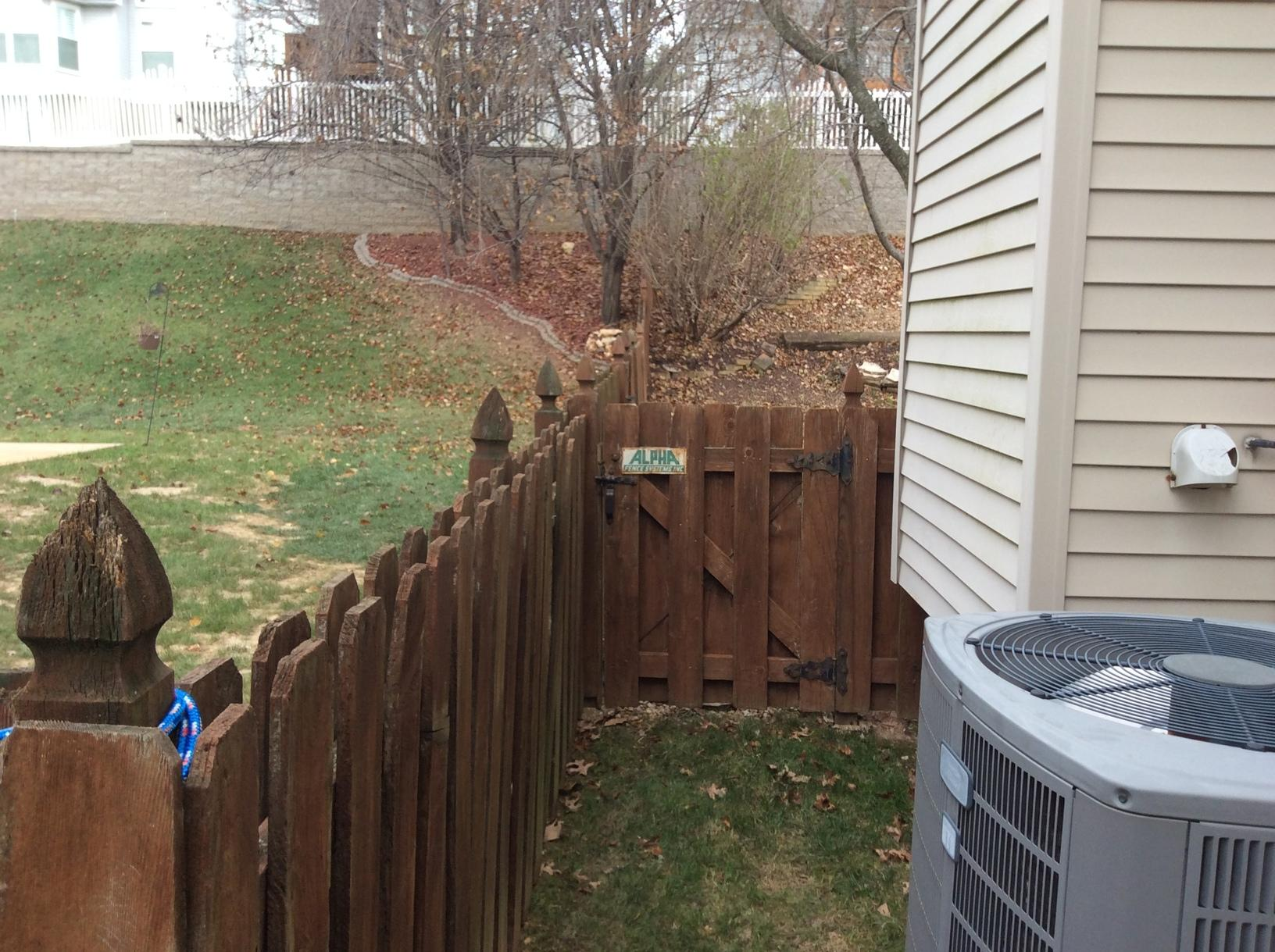 St Louis, MO Closed Top Vinyl Fence Installed - Before Photo