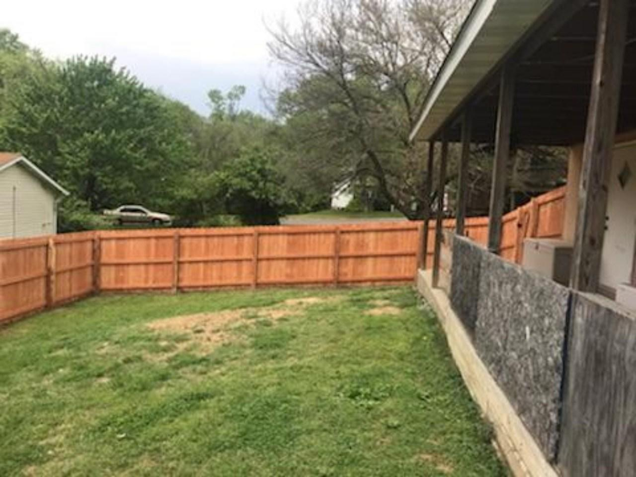Prestained Douglas Fir Privacy Fencing in Bethalto, IL - After Photo