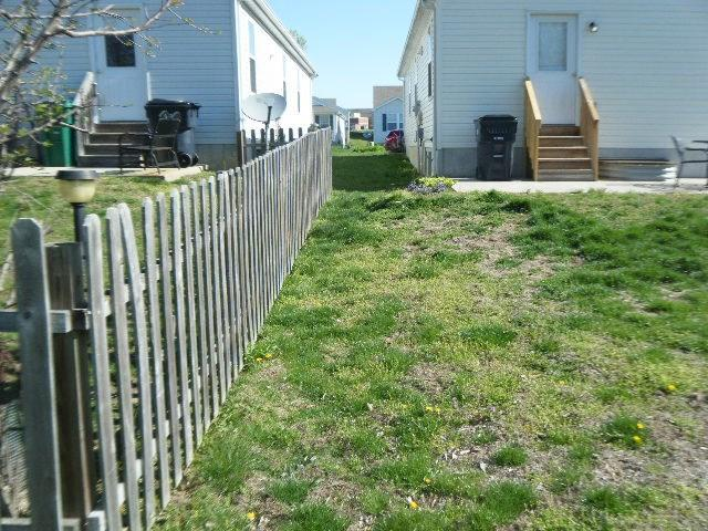 Cedar Picket Fencing Installed in Belleville, IL - Before Photo