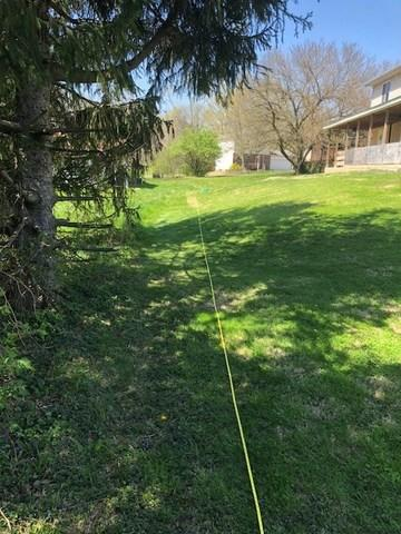 Prestained Douglas Fir Privacy Fencing in Bethalto, IL - Before Photo