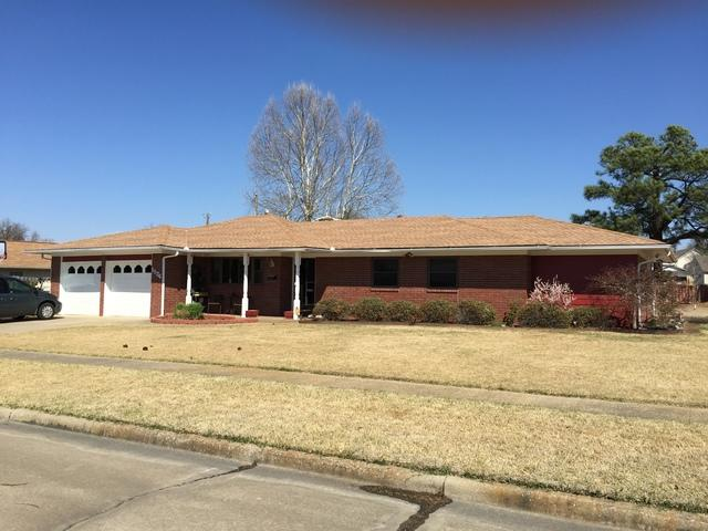 Total Roof Replacement in McAlester, OK - Before Photo