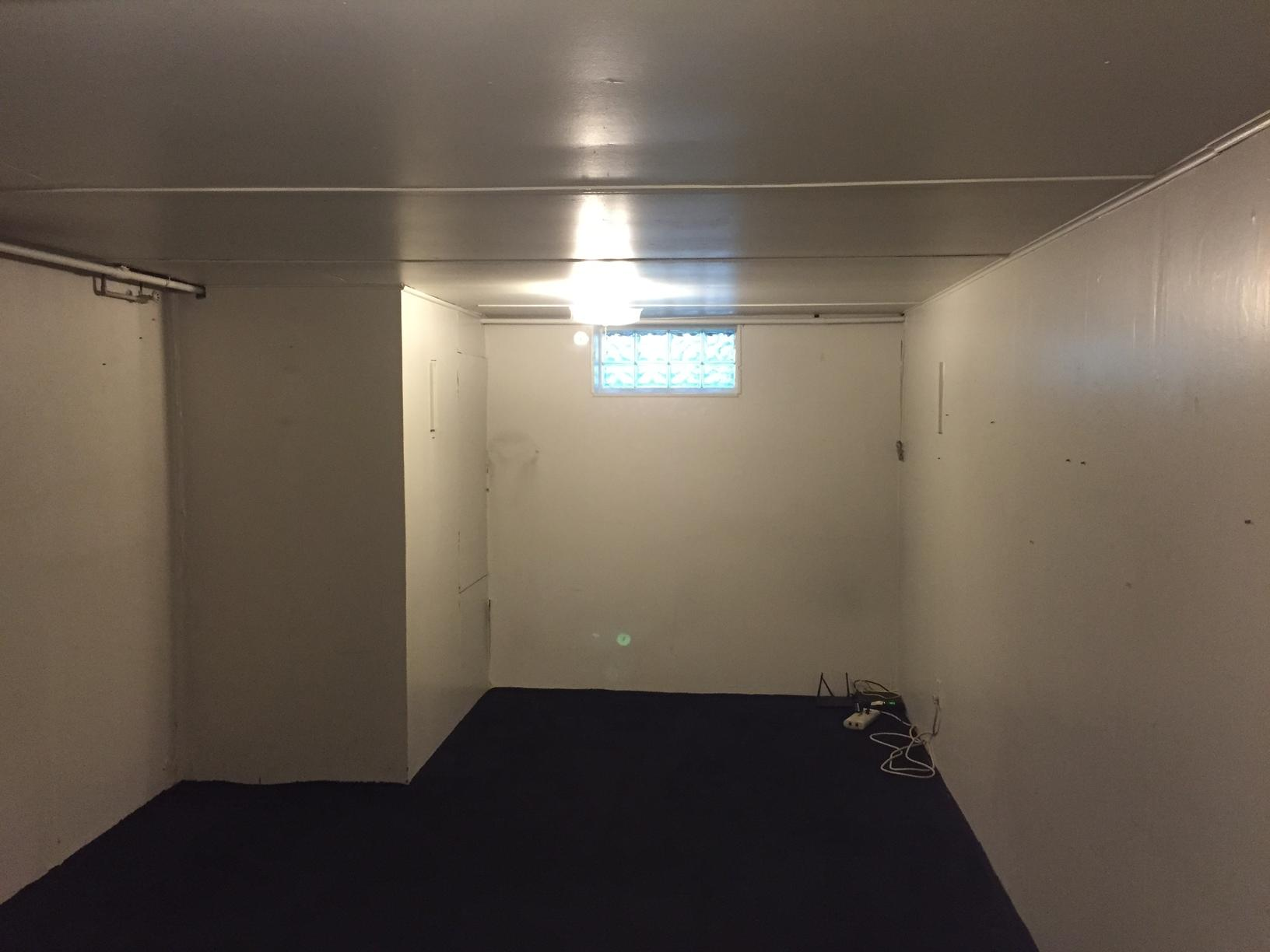 Uninviting Basement Bedroom is Brightened in Albany, NY - Before Photo