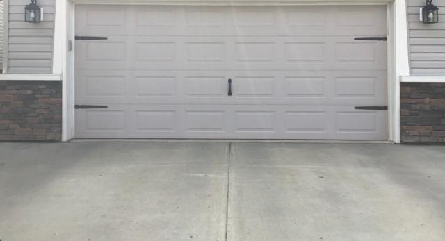 Sunken Driveway Leveled to Meet Garage Pad in Edmonton, AB