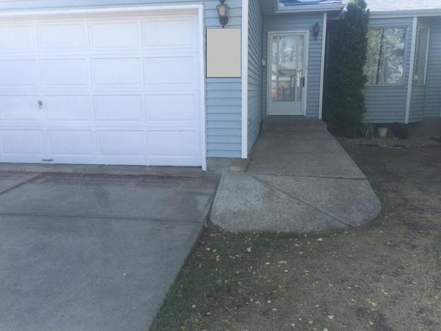 Driveway & Sidewalk Lifted in Edmonton, AB (Click Photos to Enlarge) - Before Photo