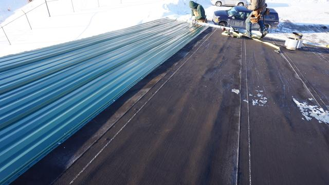 A Commercial Building Gets A New Metal Roof!
