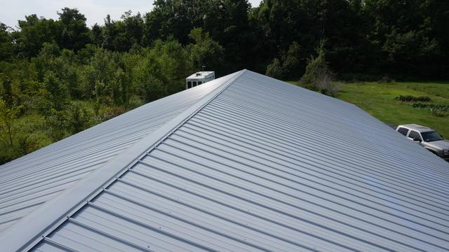 Metal Roofing-Light Blue Standing Seam Roof Installation in Grand Ledge, MI