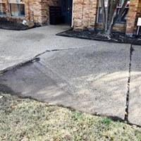Cracked and Sinking Driveway Fixed in Dallas, TX - Before Photo