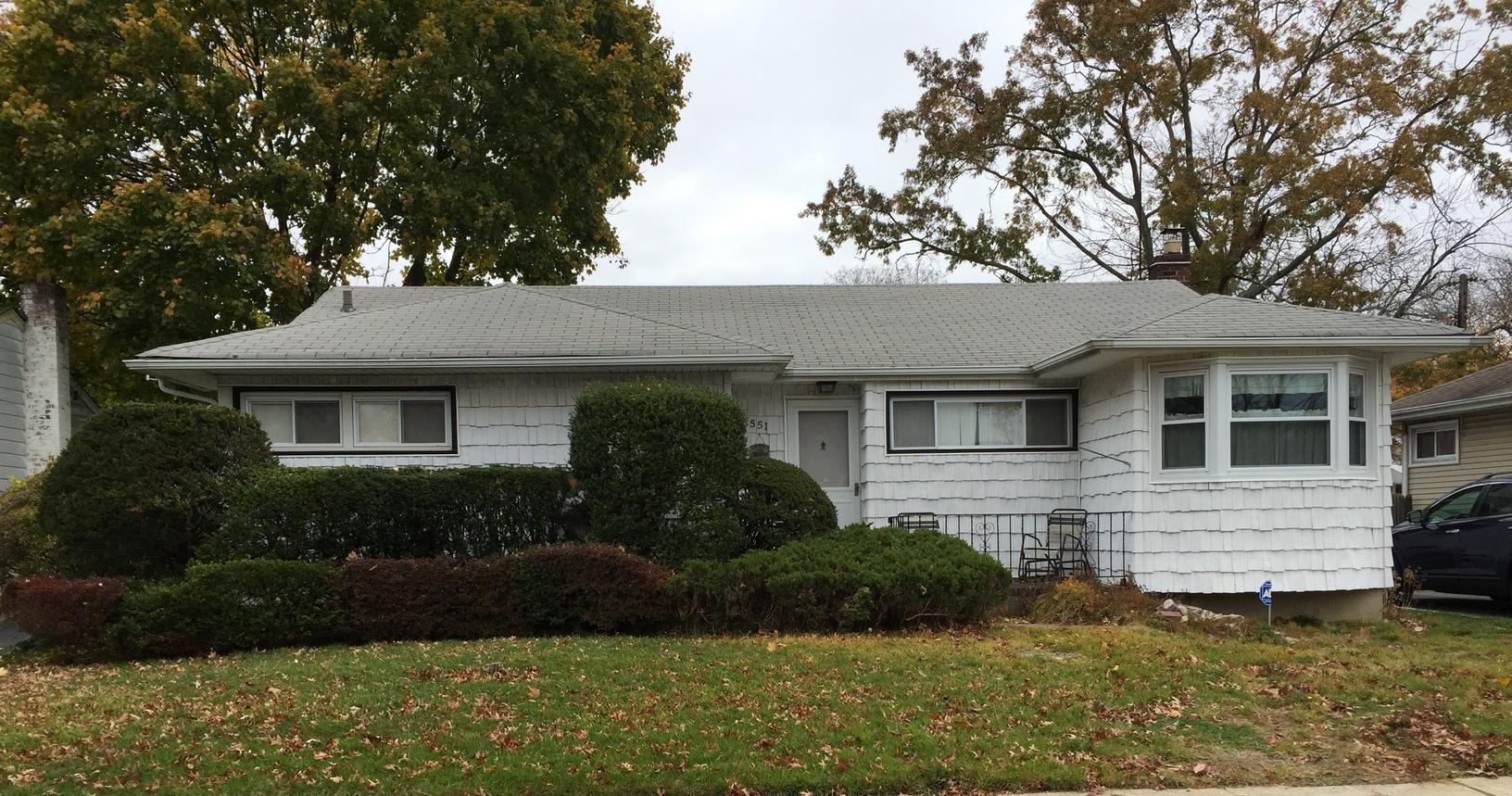 East Meadow Roofing & Siding Replacement - Before Photo