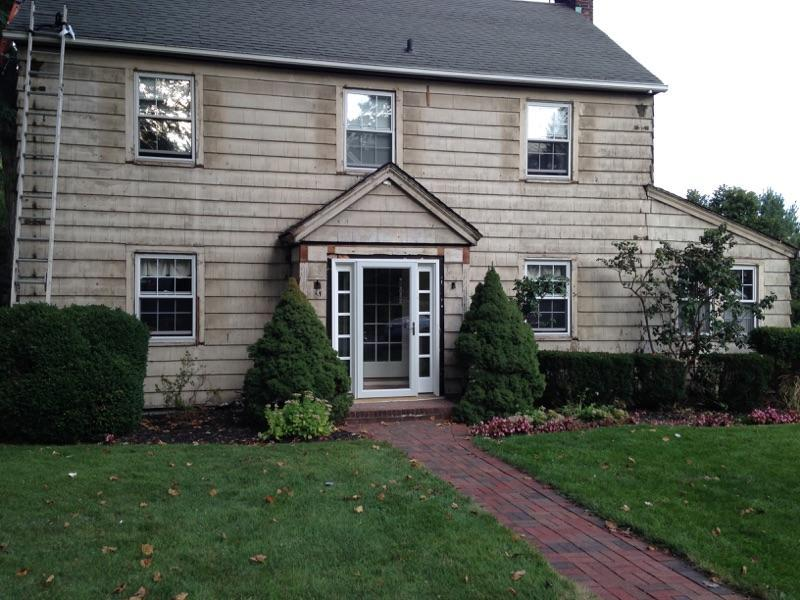 Siding Installation in Manhasset, NY - Before Photo
