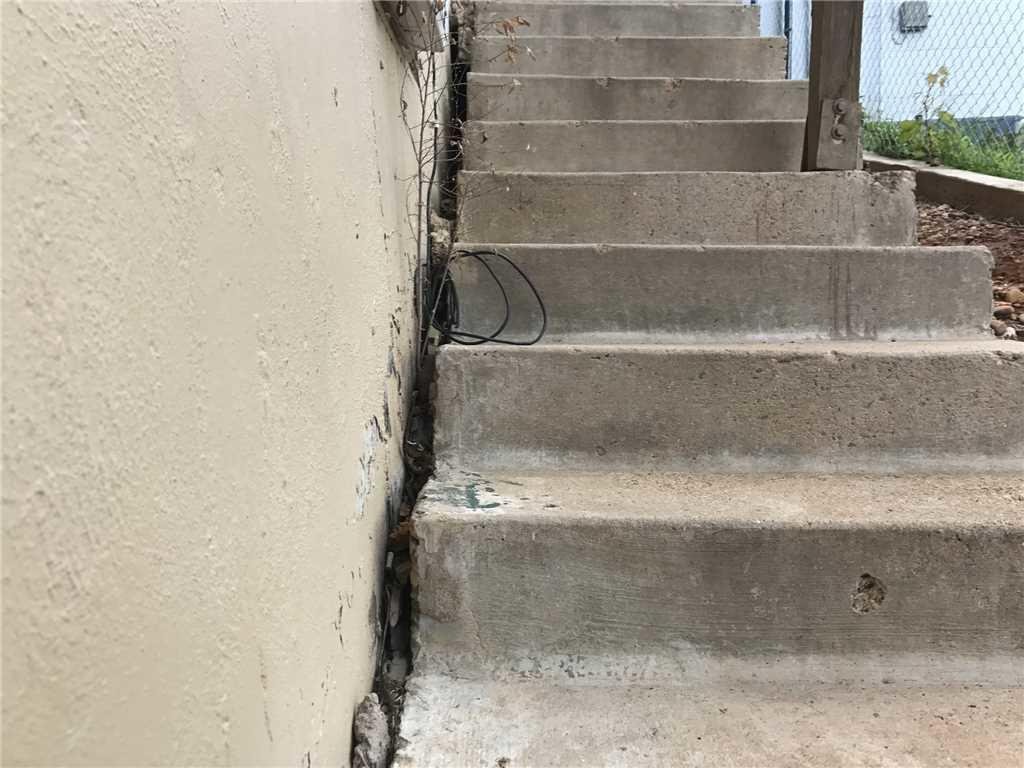 Lift Concrete Steps at an Apartment Complex in Borger, TX - Before Photo