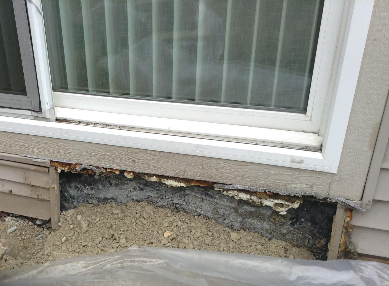 Lockport, IL Patio Door Siding Repair - Before Photo