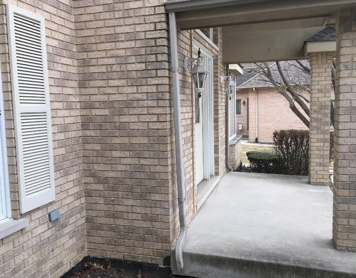 Downspout attachment in Orland Park, IL - Before Photo