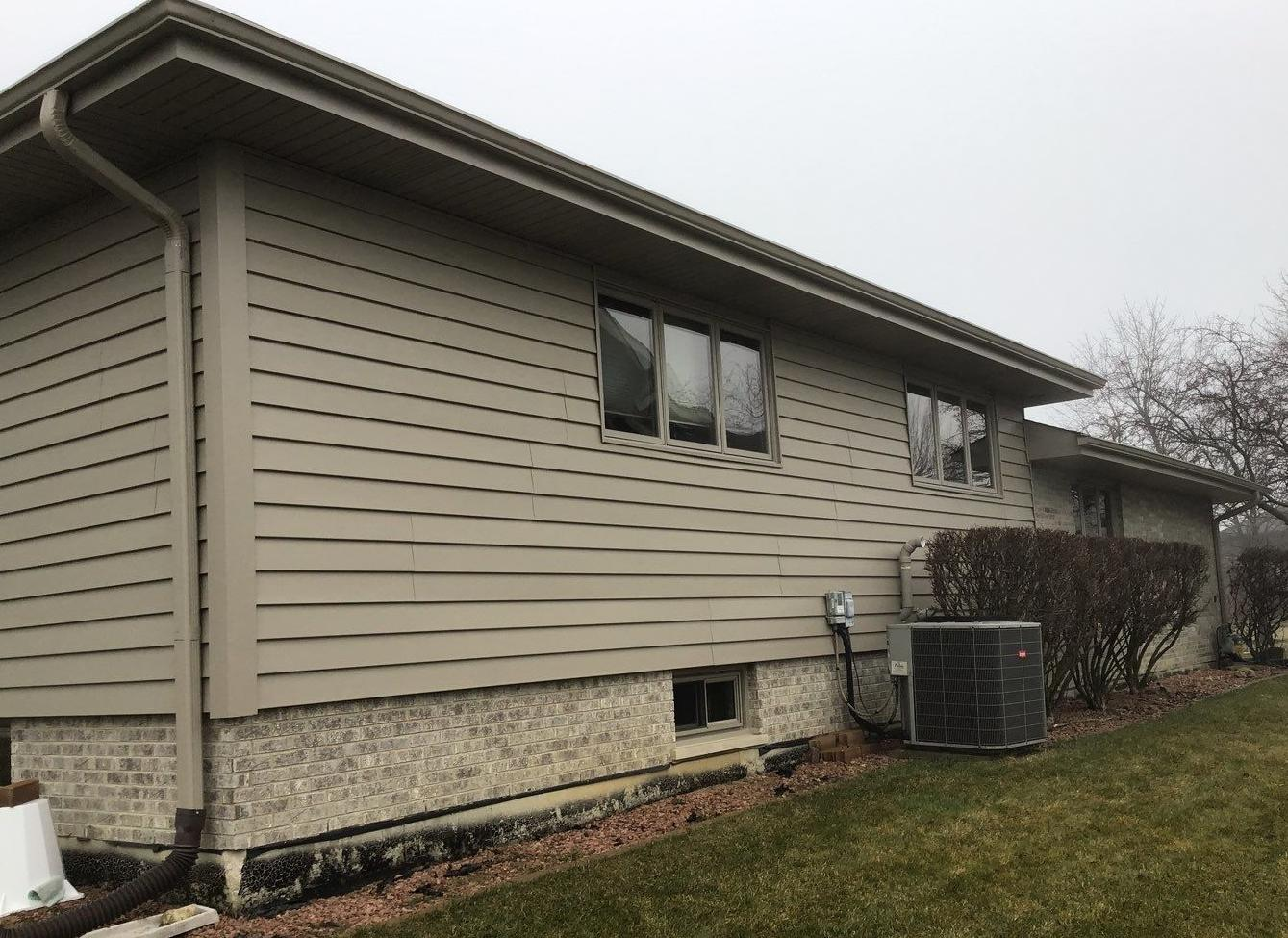 Vertical to horizontal Siding Replacement in Lemont - After Photo