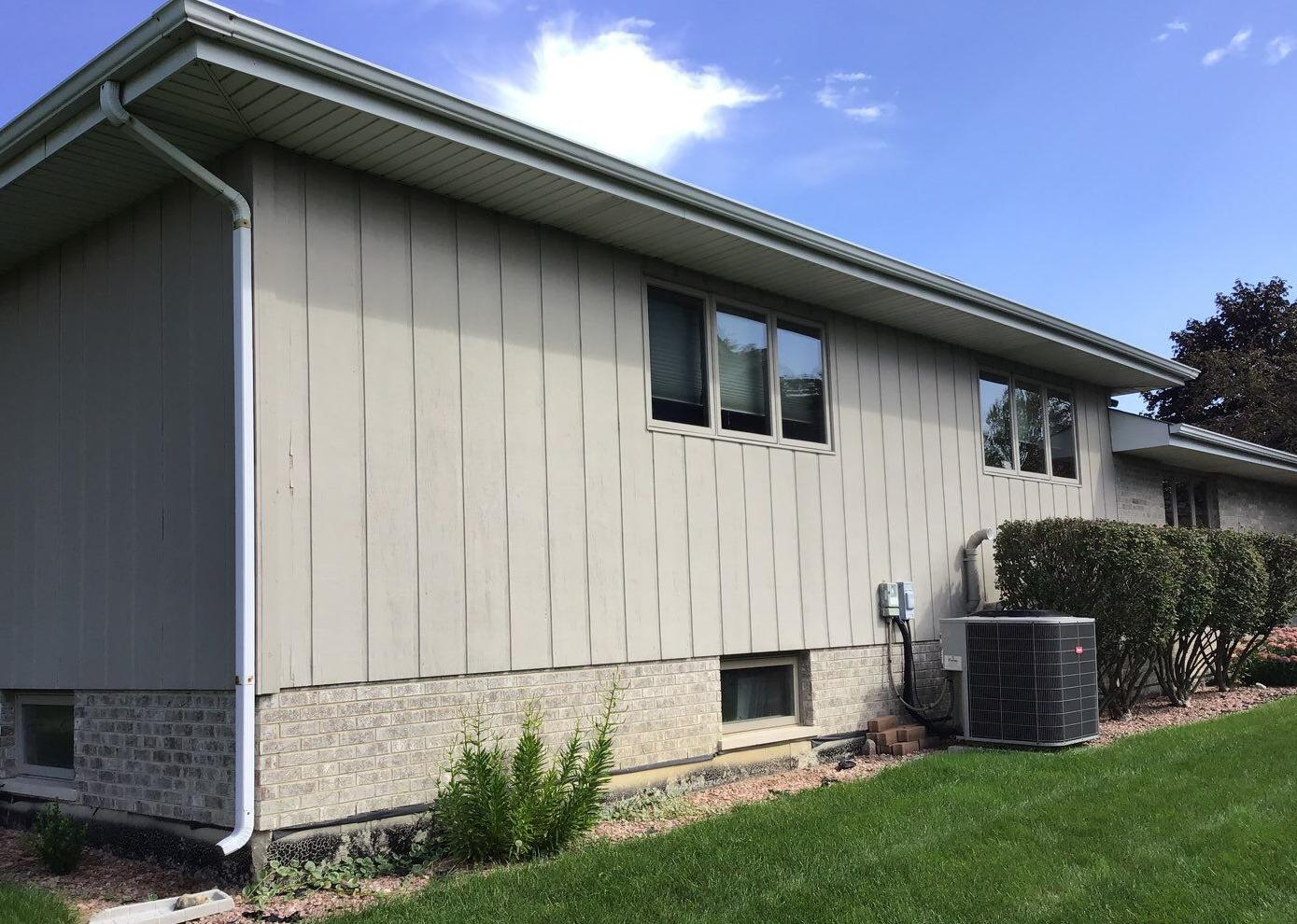 Vertical to horizontal Siding Replacement in Lemont - Before Photo
