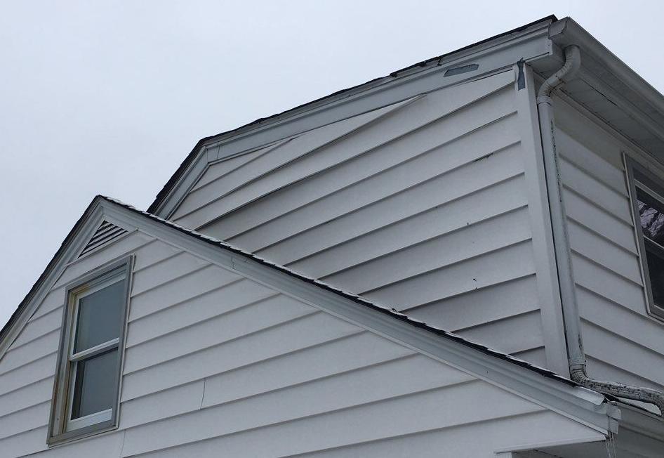 Buckling Siding Repair in Frankfort - Before Photo