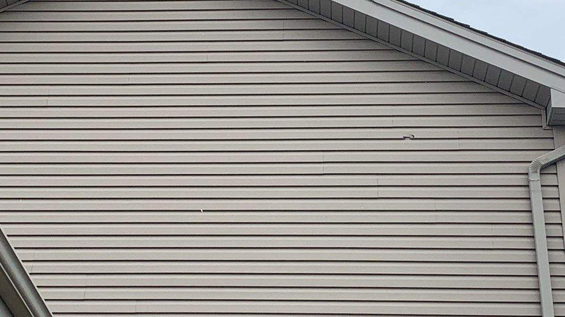 Siding repair in Tinley Park, IL - Before Photo