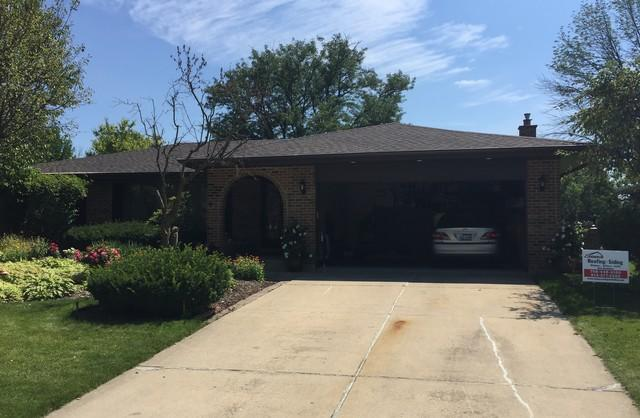 Darien, IL roof, gutter, and ridge vent replacement project