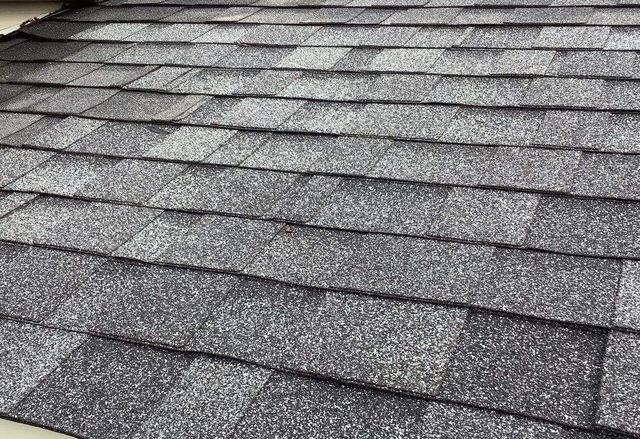 Repairing buckled roof in Orland Park, IL