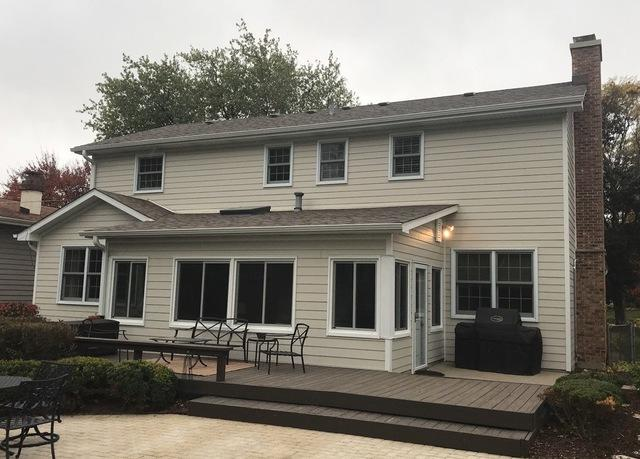 Hail damage to roof and siding in Wheaton, IL